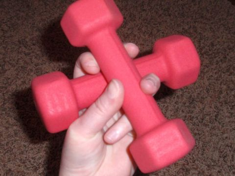 A pair of pink dumbbells