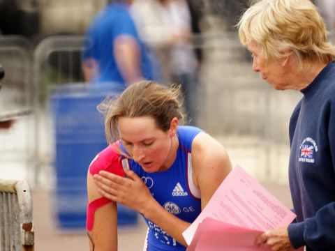 A female biathlete finishing her race despite injury