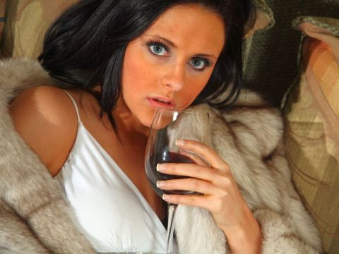 Woman hold glass of red wine