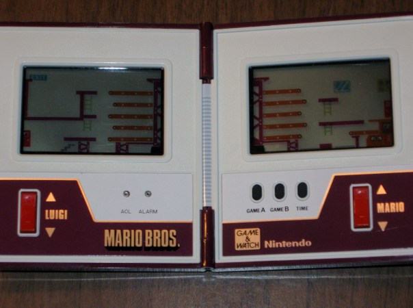 Here's a look at the inside.  I haven't purchased new batteries for the game yet, but I remember the objective being to help Mario and Luigi stack boxes onto a truck without dropping any.  It was really fun and gotten taken away from me for the day by my 4th grade teacher when it started beeping in the middle of class.