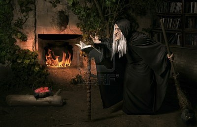 9435653-halloween-witch-with-her-magic-book-casting-a-spell1