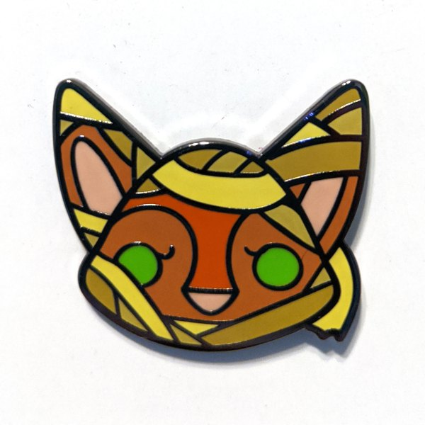 A photo of an enamel pin of a mummy mixed with a cute fox