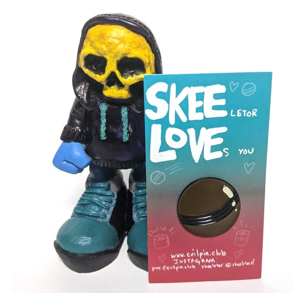 Skeeletor figure and a skee-ball pin