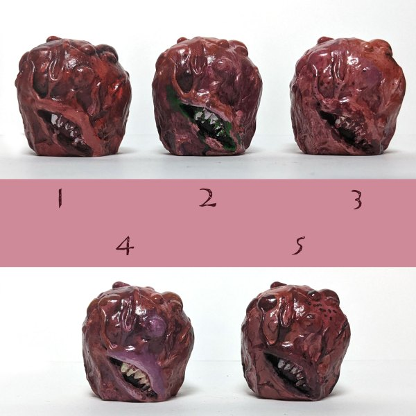 small meat monster head sculptures