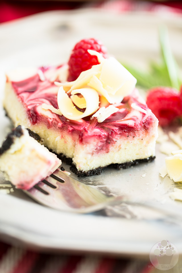 An irresistibly delicious combination of sweet Oreo cookie crust, creamy white chocolate cheesecake and a beautiful swirl of raspberry puree.