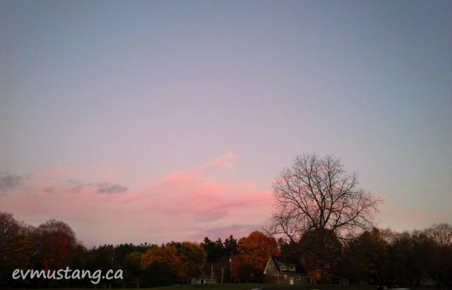 image of low, pink clouds in a mauve sunset sky