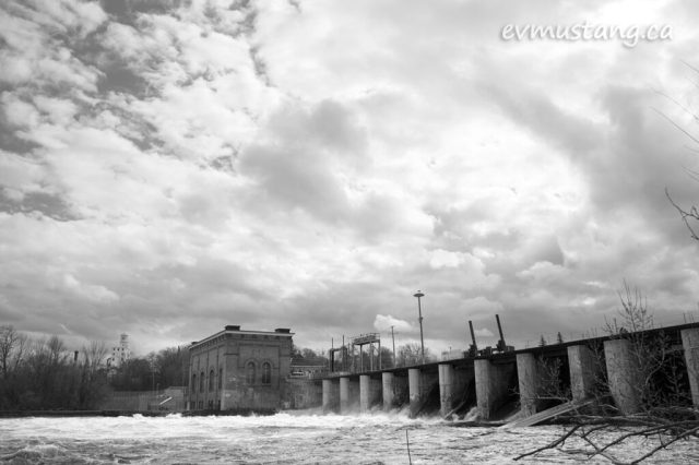 image of the london street dam with all gates open with rushing water