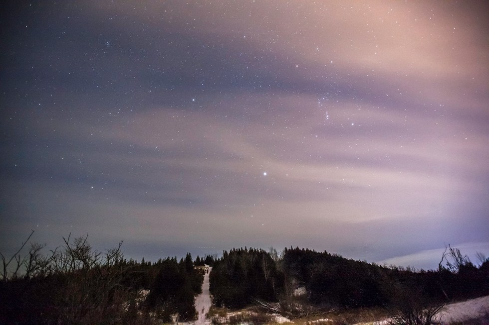 image of the starts in a winter sky with gauzy clouds over harold town hill