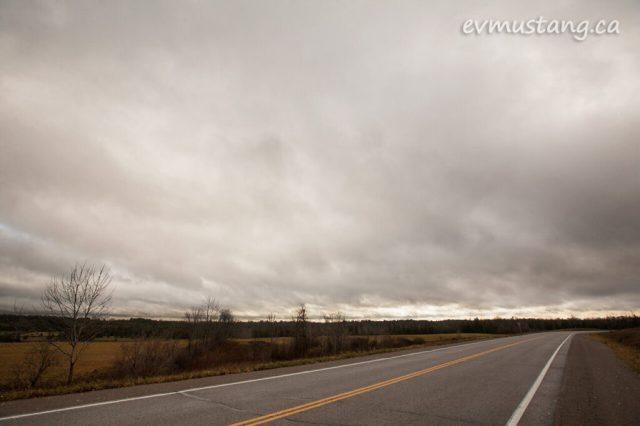 image of dark november sky over two lane county road