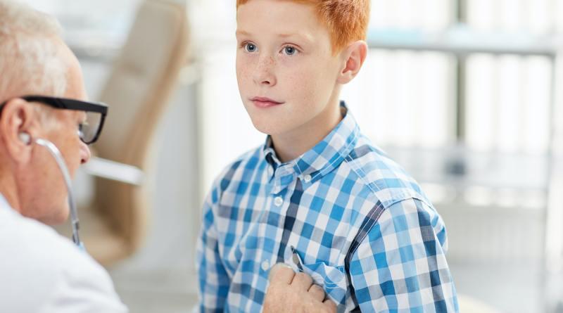 Pediatrician Listening to Breath of Child