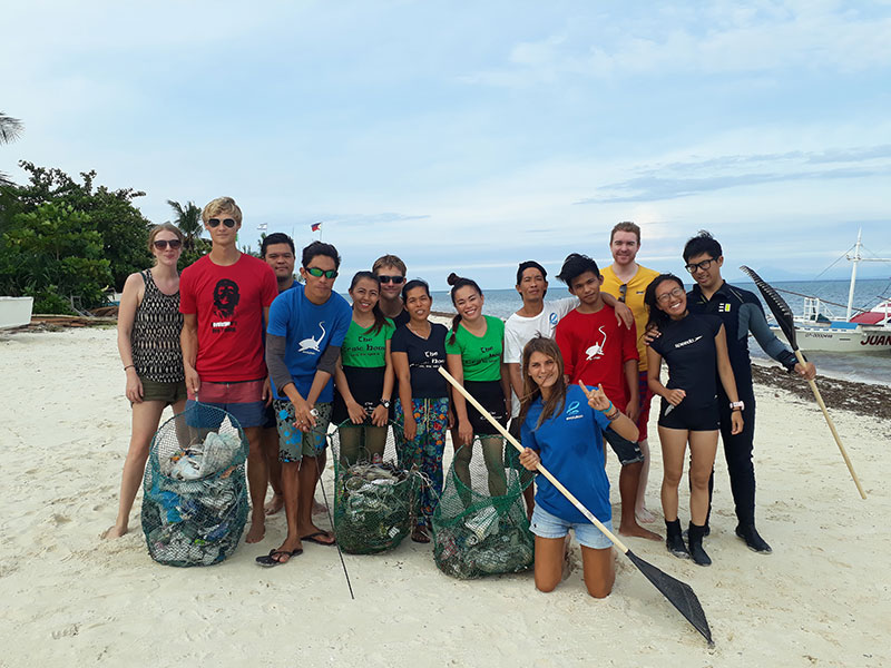 Beach clean up after Tropical Storm Urduja evolution diving resort