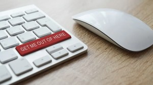 A red button (get me out of here) on a computer keyboard.