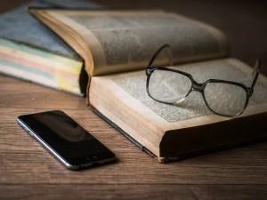 Book, glasses, phone