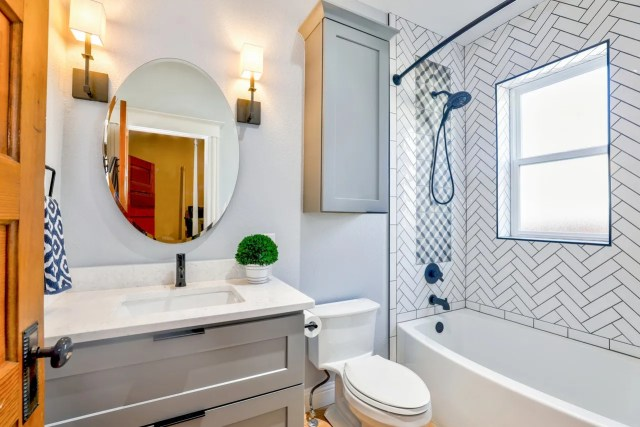 A white bathroom - while cleaning an apartment before moving out, focus on the bathroom