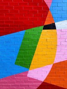 colorful mural on brick wall