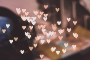 pink and white hearts over blurred photo