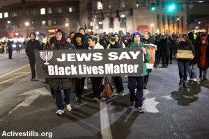 """people holding banner reading """"Jews say Black Lives Matter"""""""