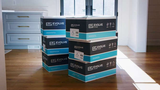 stack of evolve stone boxes on table