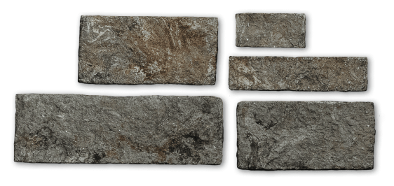 individualized brown stone veneer pieces in different sizes on white background