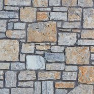 rectangular stone veneer with mortar between the stone with a distressed tan on grey stone