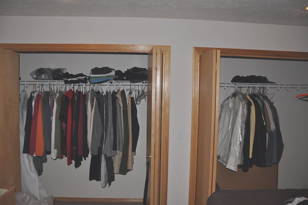 His and Hers closets showing our downsizing progress, left side of closet has far more than the right.