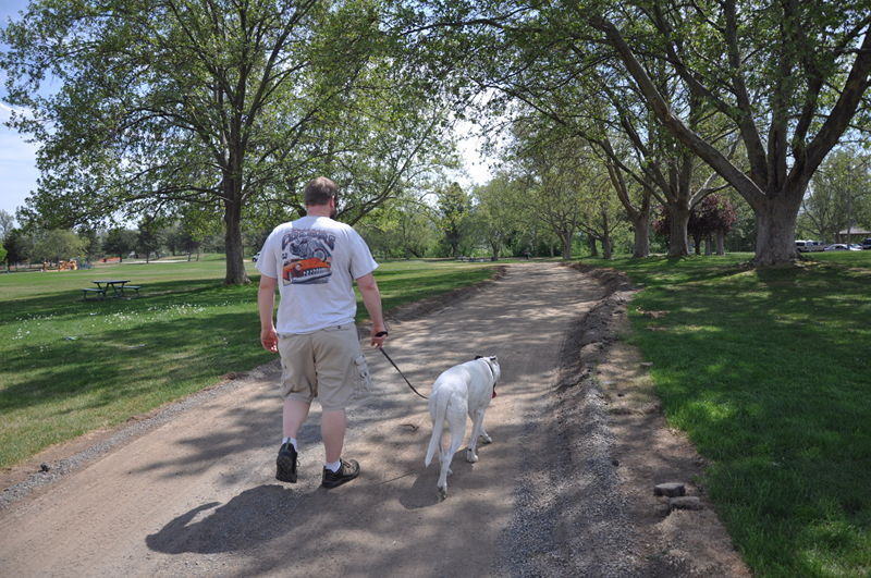 Adam and Ace walking a dirt path in the park while traveling the country by RV full time.