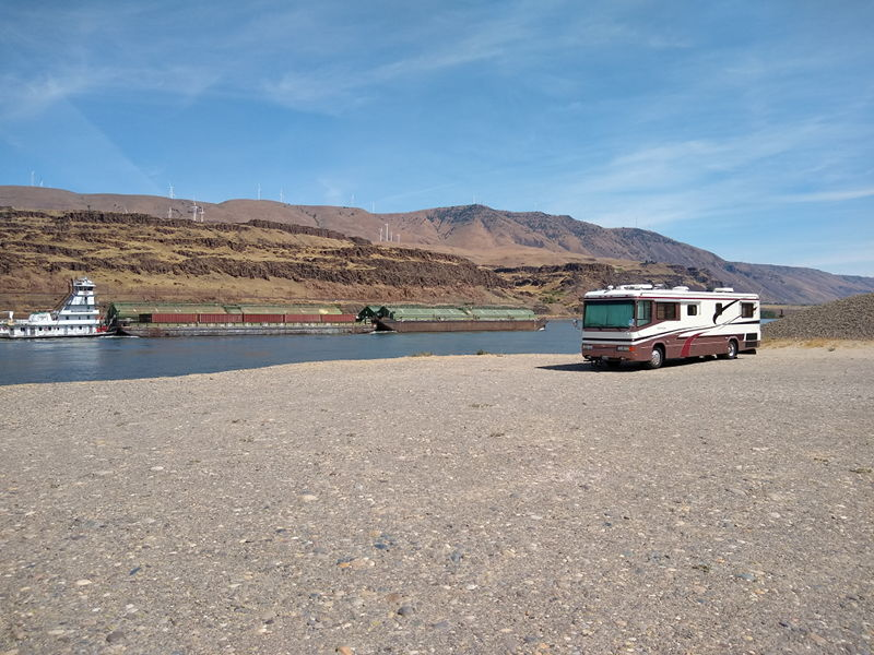 The barge pushing some cargo up the Columbia River with the RV we live in full time parked only feet from the edge of the river.