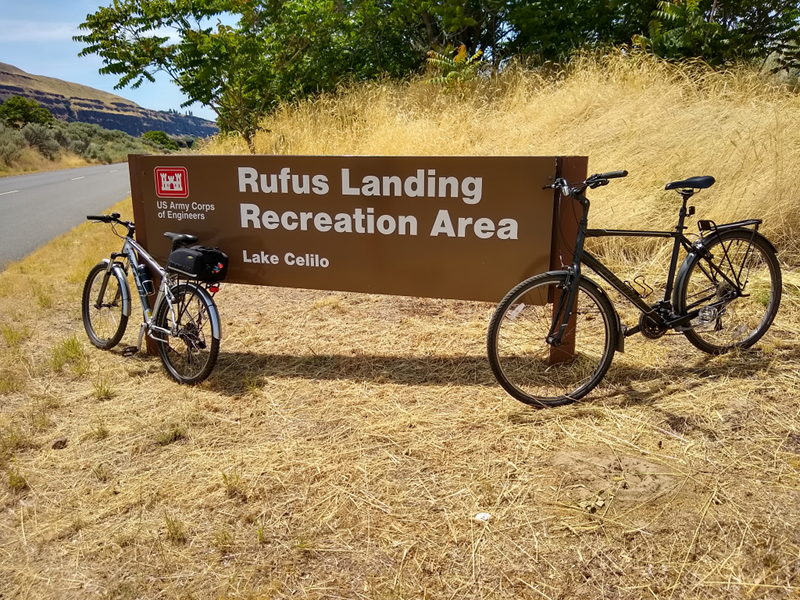 Sign for Rufus Landing Recreation Area with our bicycles leaning against the sign while touring the area on our full time RV adventure.