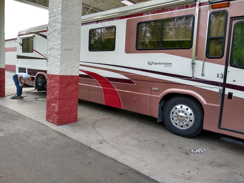 New tires being put on the RV at Les Schwab in Portland, OR on our full time RV adventure.
