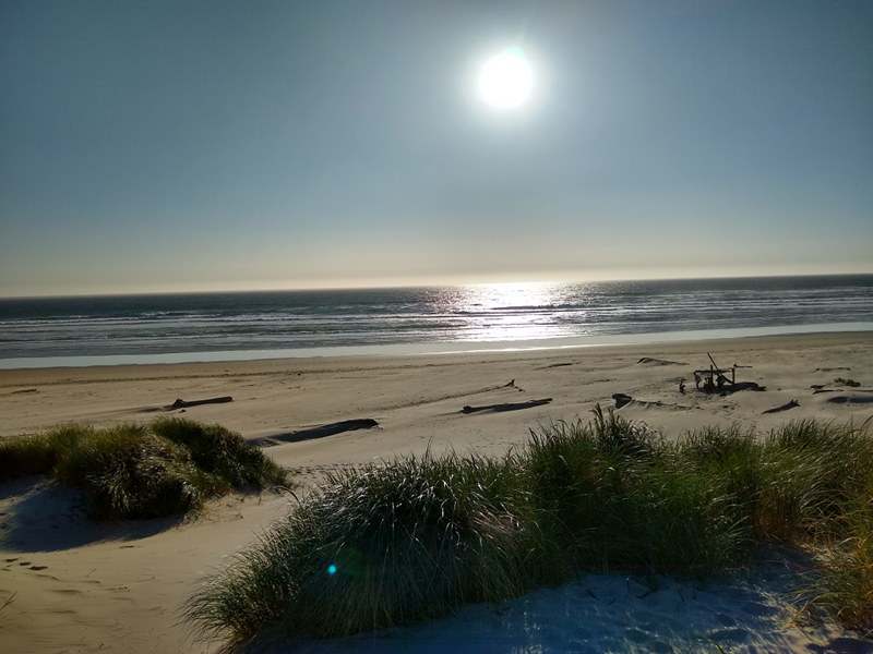 It's almost sunset at Nehelam Bay State Park on the Oregon Coast while we are living in our RV full time on this adventure.