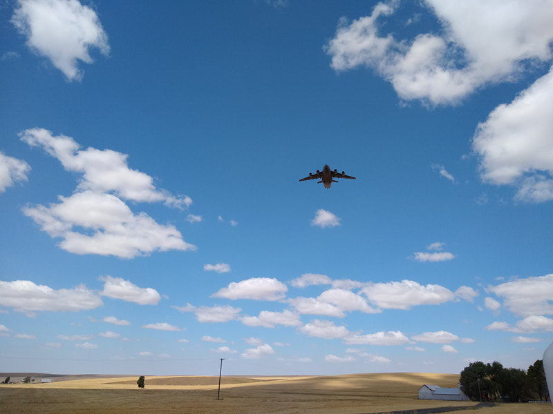An Air Force jet flys low over us during my seasonal job out in the field as we travel around the country full time in our RV.