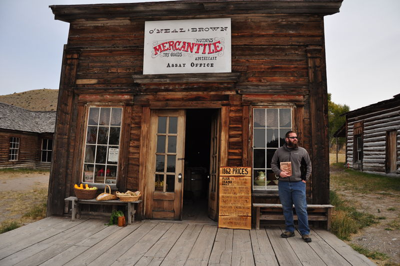 Adam standing in front of the old mercantile building in the ghost town of Bannack, Montana during our full time RV adventure traveling the country.