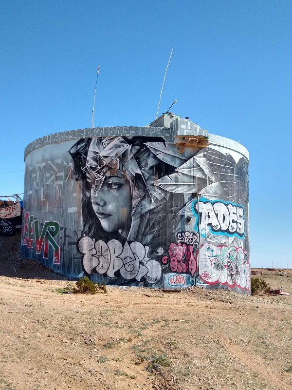 Beautiful artwork on the side of an old cistern.
