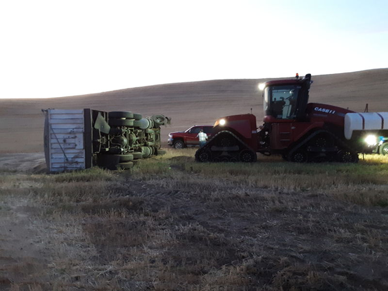 Truck tipped over in the field after blowing a tire and going off road.