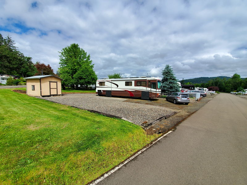 Our RV site at Timber Valley SKP in Sutherlin, OR during our trip around the US.