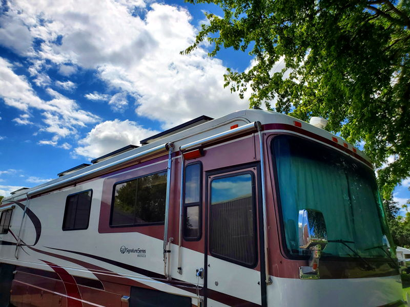 """Side view of the RV showing the height of the solar panels with 4"""" solar panel brackets."""