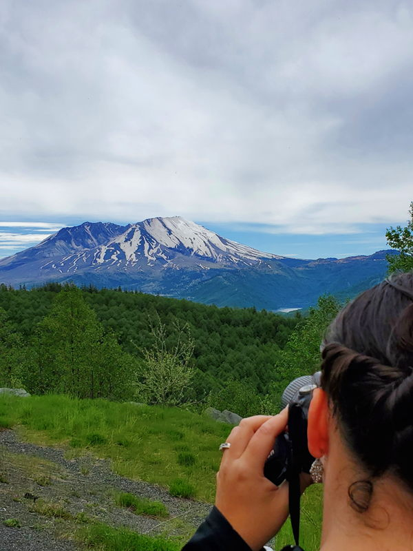 Adrianne taking a picture of Mt St. Helens with her Nikon camera.