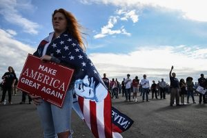 November 4, 2018 - Macon, Georgia, US - KENLEA DAVIS, listens to President Trump in Macon, Georgia Sunday, where Trump rallied support for GOP candidate for Governor Brian Kemp. With two days until the election, Kemp is tied in polls with Democrat Stacey Abrams, who could become the nation's first black female governor. (Credit Image: © Miguel Juarez Lugo/ZUMA Wire)