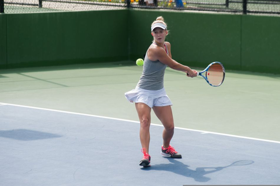 47992418 - female tennis player has ball lined up for a backhand.