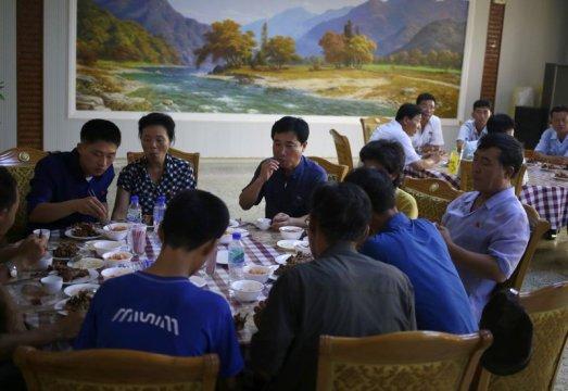 Man bites dog: North Koreans eat dog meat to beat the heat