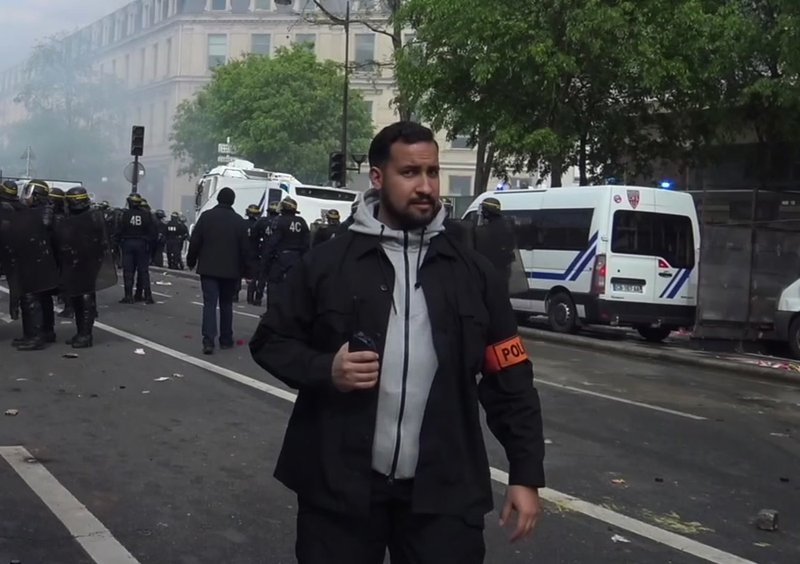 Crisis for Macron as security aide is detained for beating