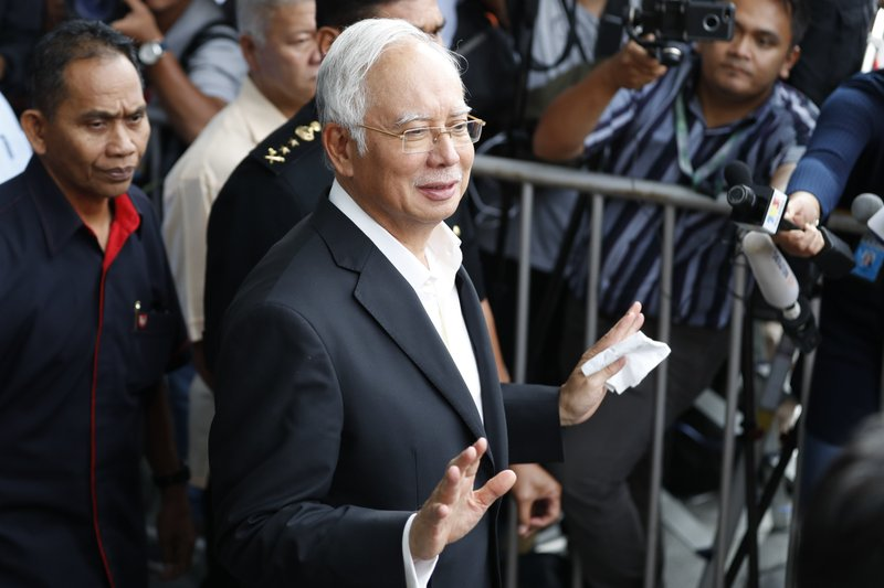 Former Malaysian leader arrested, to be charged with graft
