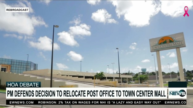 PM defends post office move