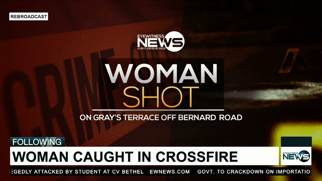 Woman shot while sitting in vehicle