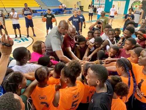 Patrick Ewing, U.S. Chargé Bowers Dare Bahamian Youth to Dream Big