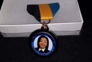 Outrage over Youth minister's medallion