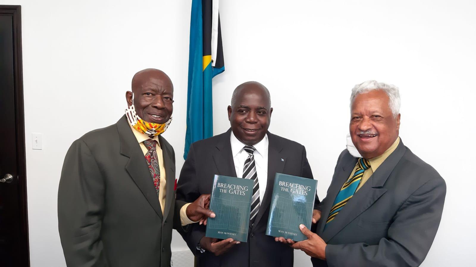 Evangelist Rex Major presents book to Opposition leader