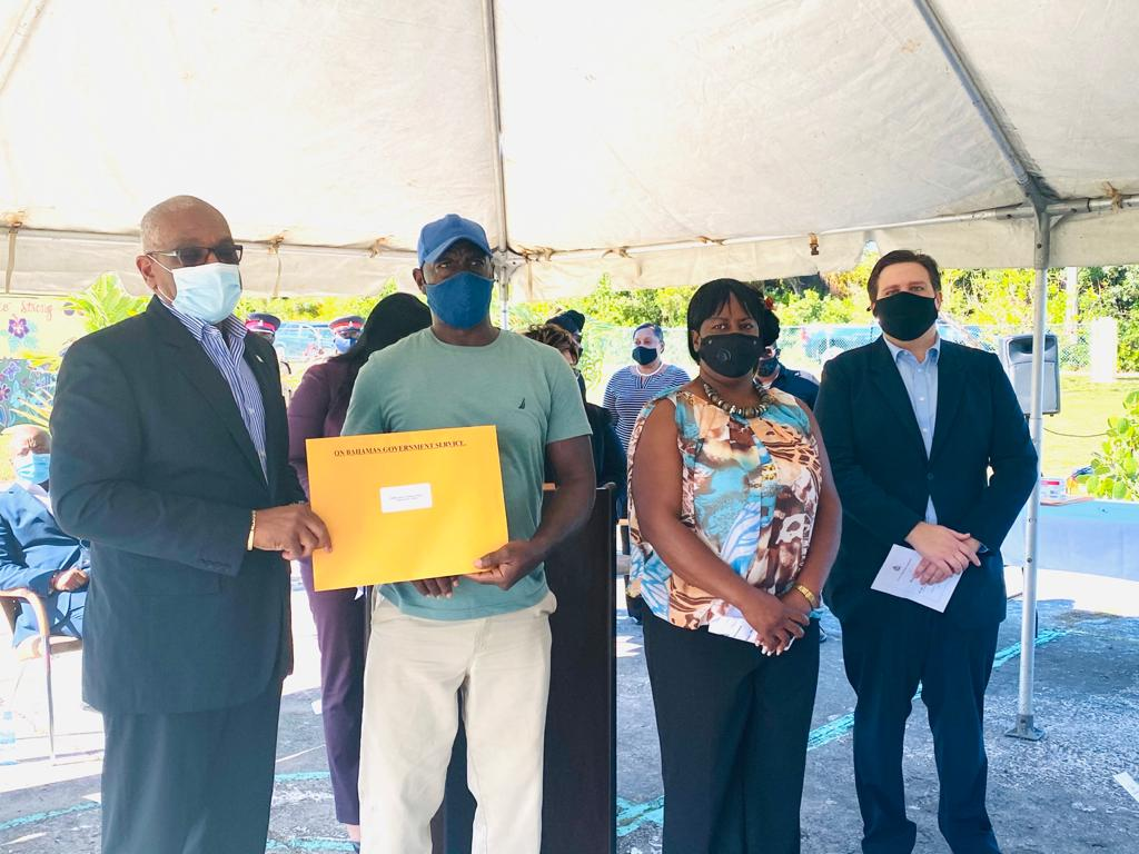PM presents 24 Crown Land grants to residents of Crossing Rocks, Abaco