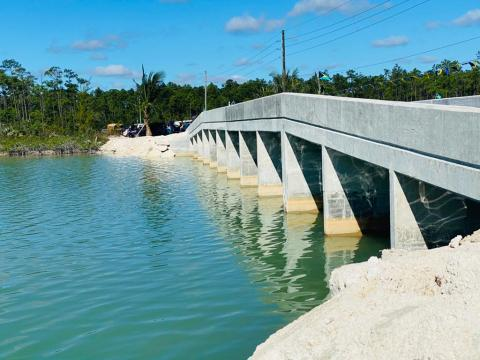 Family Island infrastructure works continue; London Creek Bridge opened on Andros