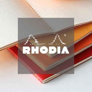 Rhodia logo in front of dotted leatherette premium notebook